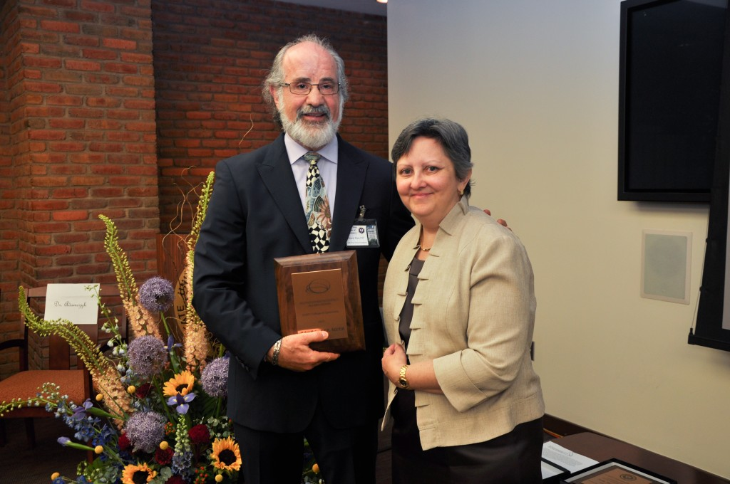 Diane T. Adamczyk, OD, FAAO Director of Residency Education presenting the Award to Dr. Sanet